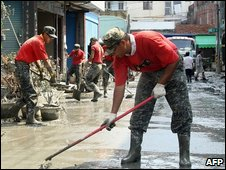 Military soldiers helping to clean the streets of Linbian, in southern Taiwan