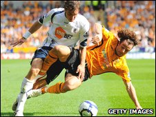 Johan Elmander takes on Stephen Hunt