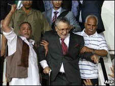 Libyans greeting freed Lockerbie bomber Abdelbaset Ali Mohmet al-Megrahi on his arrival in Tripoli, 20 August 2009.