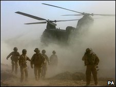 UK troops and a Chinook helicopter