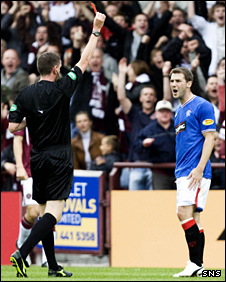 Kevin Thomson receives a red card following his lunge on Ian Black