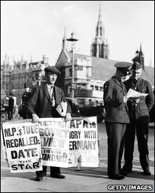 A newspaper seller in London's Parliament Square, 22 August 1939