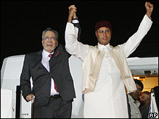 Abdelbaset Ali al-Megrahi, pictured with Col Gaddafi's son after arriving in Tripoli