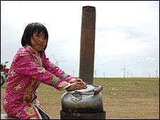 Young girl outside her family's yurt at Huitengxile wind farm, Inner Mongolia