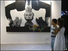 A painting depicting US President Barack Obama is displayed at the India Art Summit in Delhi