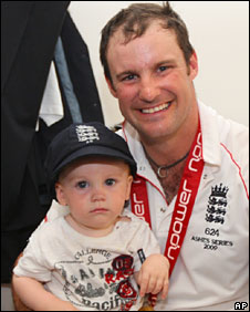 Andrew Strauss celebrates England's Ashes win with his one-year-old son Luca