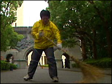 A student at the Matsushita Institute sweeps the grounds