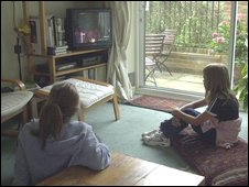 Young girls watching TV