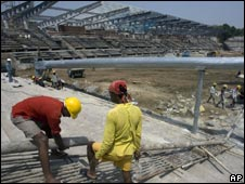 Workers at the construction site of the National Stadium, the venue for hockey matches for the upcoming commonwealth games, in Delhi on 24 Aug 2009