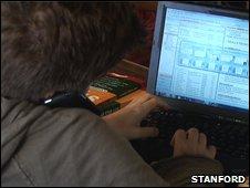 Multitasker at computer (Stanford U)