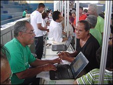 Brazilian woman registering her Amazon land claim with government official
