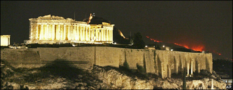 Acropolis with fire behind