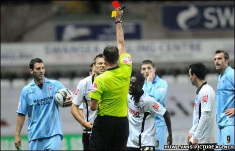 Swansea's Gorka Pintado is shown the red card by the referee