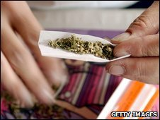 A man makes a marijuana joint (file image)