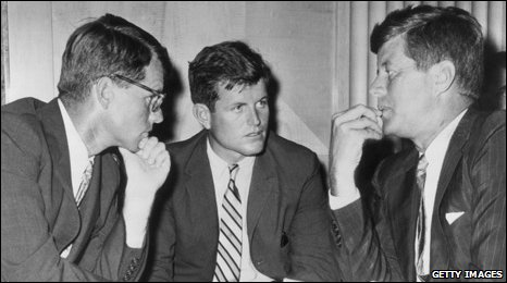 Robert Kennedy, Edward Kennedy and then US President John F Kennedy - speaking while seated behind a desk, circa 1962