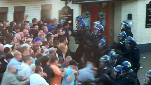 Football fans confront police