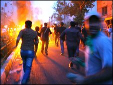 Supporters of Mir Hossein Mousavi run through streets during a demonstration in Tehran