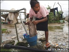 A young woman washes clothes in Dili, East Timor (file image)