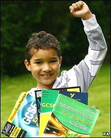 Xavier Gordon-Brown celebrates with his maths books