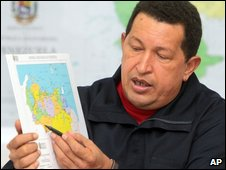 President Chavez points to a map of the border between the two countries in a news conference in July