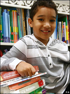 Xavier Gordon-Brown celebrates with his maths books