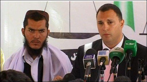 Mohammed Jawad with lawyerMajor Eric Montalvo