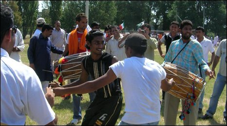 Asian amateur cricketers celebrate after the match