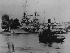 A German battleship, the Schleswig-Holstein, bombards the Polish coast at Westerplatte, at the start of World War II
