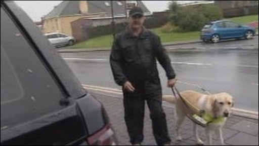 Daniel Duckfield with his guide dog in Narbeth