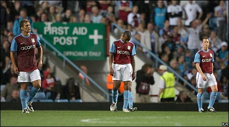 Aston Villa players show their disappointment after their elimination from Europe