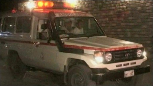 Ambulances ferry victims from the scene of a bomb at a border checkpoint in Pakistan