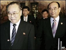 North Korean Red Cross official Choe Song-ik (L) and his South Korean counterpart Kim Young-chol (R) arrive for talks at Mount Kumgang - 28 August 2009