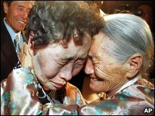Two Korean sisters are reunited for the first time in 2000 after being split during the 1950-53 war - 15 August 2000 file photo