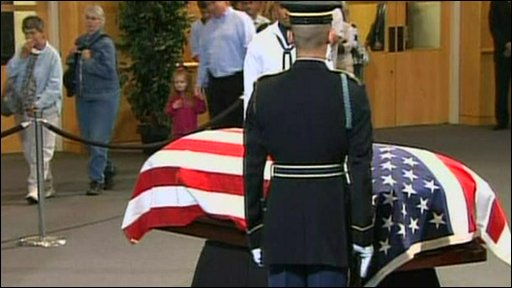Senator Edward Kennedy's coffin lies at the Kennedy Memorial Library in Boston