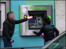 child stealing from cash point