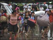 Refugees fleeing from Kokang in Myanmar arrive at the Chinese border town of Nansan, Yunnan province on 25 Aug