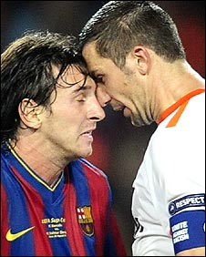 Lionel Messi (left) and Darijo Srna go head-to-head