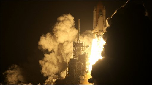 Space shuttle Discovery lifts off for the International Space Station