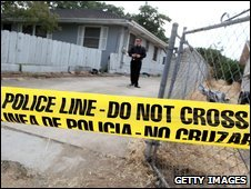 Police tape stretched across the front of the home of alleged kidnapper Phillip Garrido as police search the property in Antioch, California, 28 August 2009