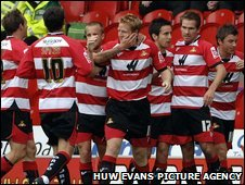 Doncaster Rovers players celebrate Adam Lockwood's opener at the Keepmoat Stadium