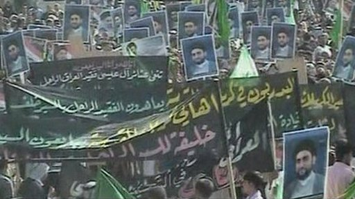 Crowds carrying posters and banners