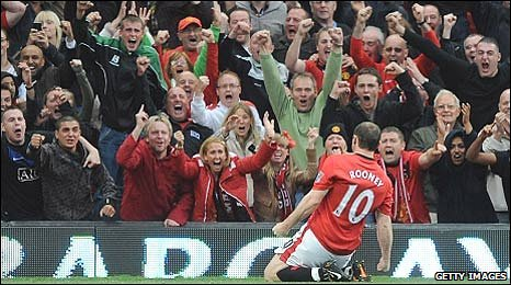 Wayne Rooney celebrates his equaliser