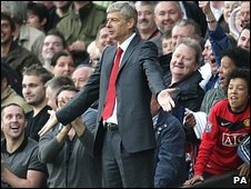 Arsene Wenger gestures after sending-off