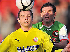 Cliftonville's Chris Scannell battles for the ball with Greg O'Halloran