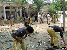 Police officers at the scene of a suspected suicide bomb attack, Mingora, 30 Aug 2009