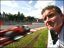 David Coulthard stands at Eau Rouge corner at Spa