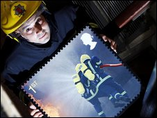 Essex firefighters holding one of the new stamp designs