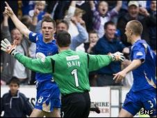 Martin Hardie (left) celebrates his late equaliser