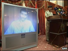 Footage shown at Iraqi police news conference showing alleged confession of Saudi-born militant