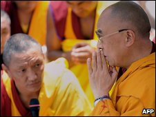 Exiled Tibetan leader Dalai Lama (R) prays in Hsiaolin